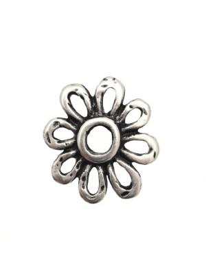 Ciondolo a forma di fiore traforato bucato al centro 25 mm.