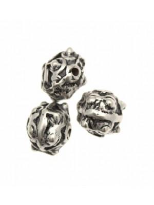 Distanziatore a palla disegnata con riga centrale liscia e sei pallini sporgenti per lato, 12x12 mm.
