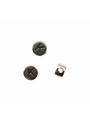 """Distanziatore tondo piatto liscio, con disegno lettera """"K"""", 7x4 mm."""