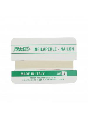 Filo infilaperle in nylon con ago compreso colore Avorio, spessore 0,5 mm.