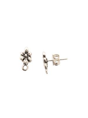 Perno a forma di fiore a sei petali, largo 7 mm., lungo 13 mm., con un anellino chiuso sotto