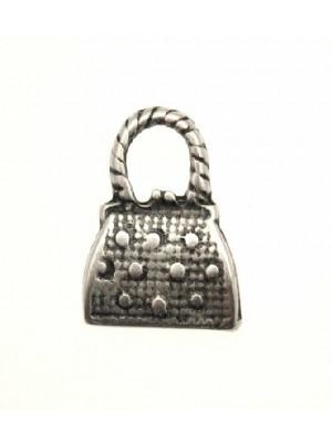 Ciondolo a forma di borsa con disegno puntinato 15x21 mm.