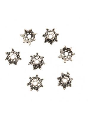 Coppetta tonda a forma di stella puntinata a sette punte, diametro 10 mm.