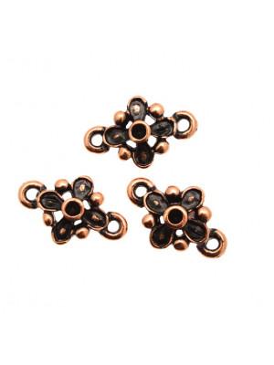 Distanziatore a forma di fiore con quattro petali e quattro palline, con due anelli, 12x17 mm.