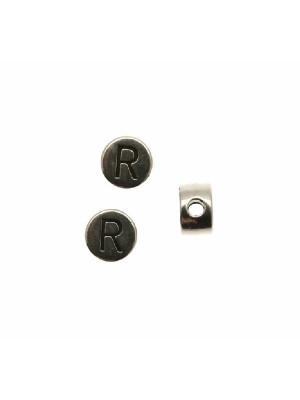 """Distanziatore tondo piatto liscio, con disegno lettera """"R"""", 7x4 mm."""
