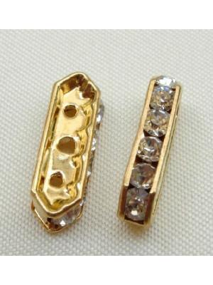 Ponte strass piatto con 3 fori, 21 mm., colore strass Crystal, colore base Oro lucido