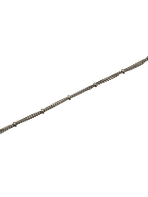 Catena composta da tre catene grumette sottilissime fermate ogni 15 mm. da una rondellina liscia