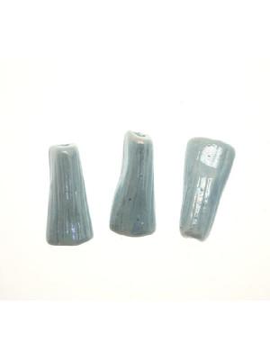Tubo schiacciato e rigato in ceramica, 25x10 mm., Colore Azzurro chiaro