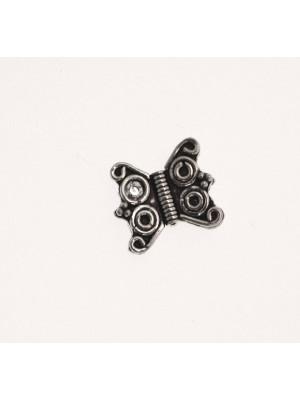 Distanziatore a forma di farfalla