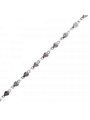 Catena alternata, in acciaio, formata da un cuore martellato su un lato 8,4x4,1 mm.